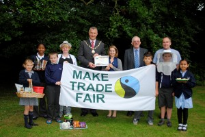 Pupils from Christ Church C of E Junior School in Downend celebrate the Fairtrade news with school cook Di Warren, Cllr Ian Boulton, Fairtrade coordinator for South Glos Lydia Nash, Jonathan Seagrave, from the Fairtrade Foundation, and headteacher Alex Wilkinson