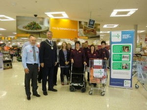 Chair of South Gloucestershire Council Ian Boulton with Sainsburys PR Ambassador Tracy Cannard and staff