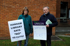 Outside Hanham Library with placards are library assistant Sheila Roberts and Andrew Went, from Unison