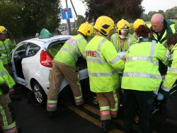 Emergency crews work to free the woman from her car after the crash in Hanham Picture: Avon Fire & Rescue