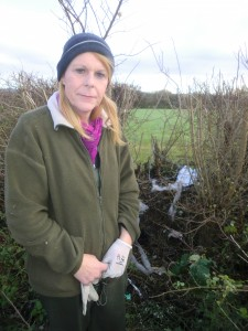 Nadine Pinkerton at the gap in the hedge where the Christmas tree thieves got in