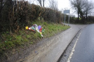 Floral tributes left at the scene of the accident