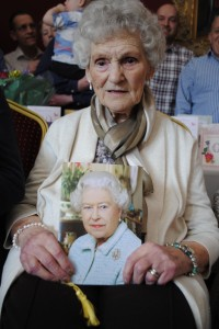 Freda Brown with her card from the Queen congratulating her on her 100th birthday