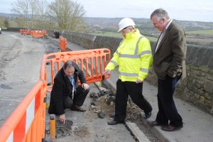 Highways service manager Kelvin Packer talks to local councillors Martin Veal and Geoff Ward about the state of the road