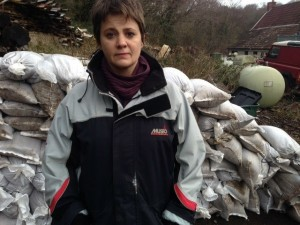 Jo McCarron with the sandbags she secured from South Gloucestershire  Council for Mr Godwin and his neighbours