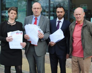 Handing in the petition and letters of objection are, from left, Jo McCarron, Cllr Martin Farmer, Amit Patel and Dave Bailey