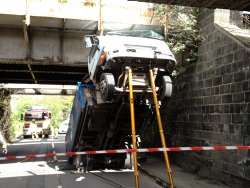 Wedged under the bridge: the lorry in Whitby Road