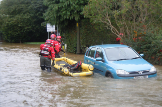 The flooding in Fisher Road on Thursday Picture: Mabel Dew