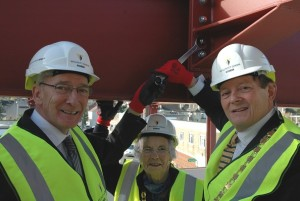 Cllr Bellotti, pictured left in 2013 at the topping out ceremony for the Keynsham town regeneration