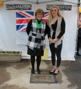 Cllr Jane Allinson and Siobhan-Marie by the plaque