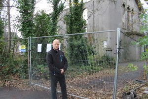 Cllr Andy Perkins outside the old chapel - the proposed car park is behind him