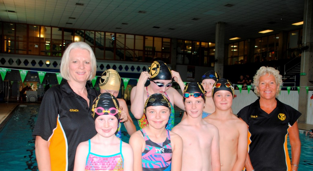 Young swimmers and coaches Lynne Bartlett, left, & Thea Beament, right, celebrating Siobhan-Marie's success today